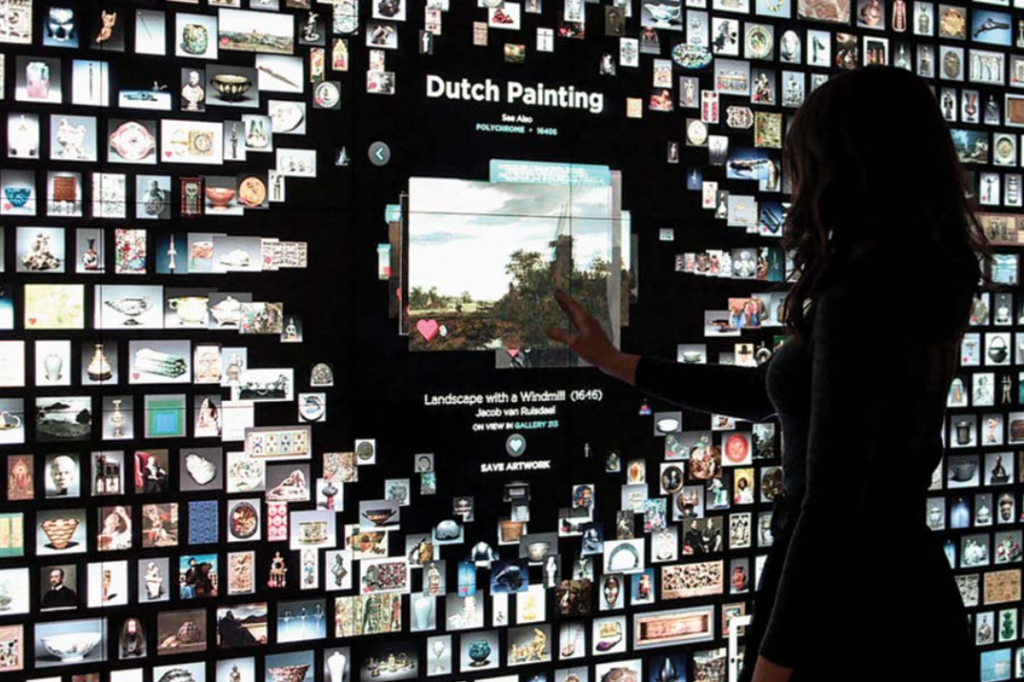An image of a woman looking at a digital art exhibit.