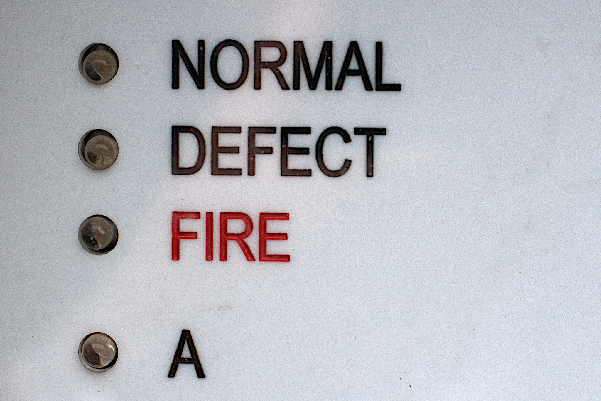 Image of indicator lights labeled Normal, Defect, and Fire