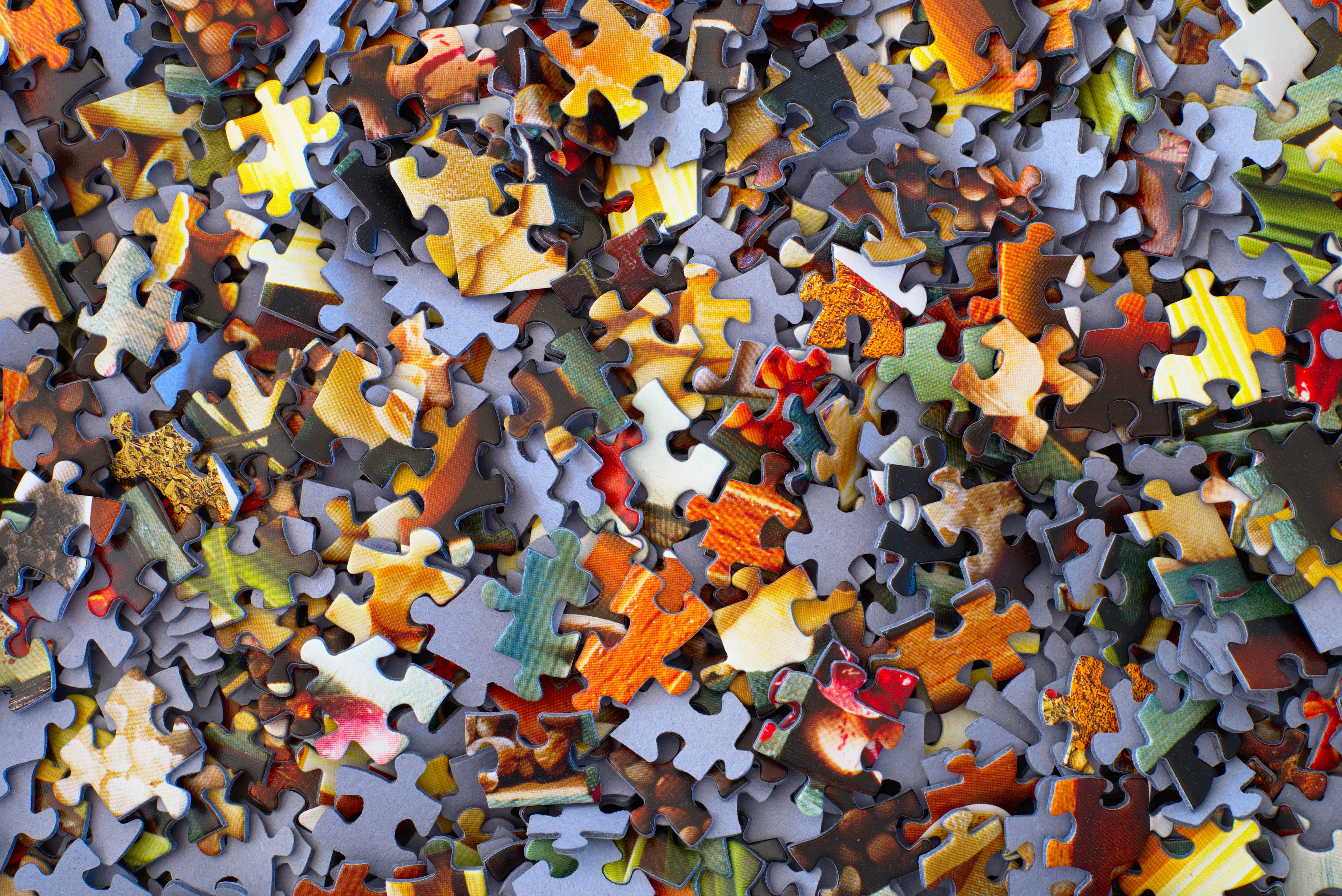 Image of a pile of multicolored puzzle pieces