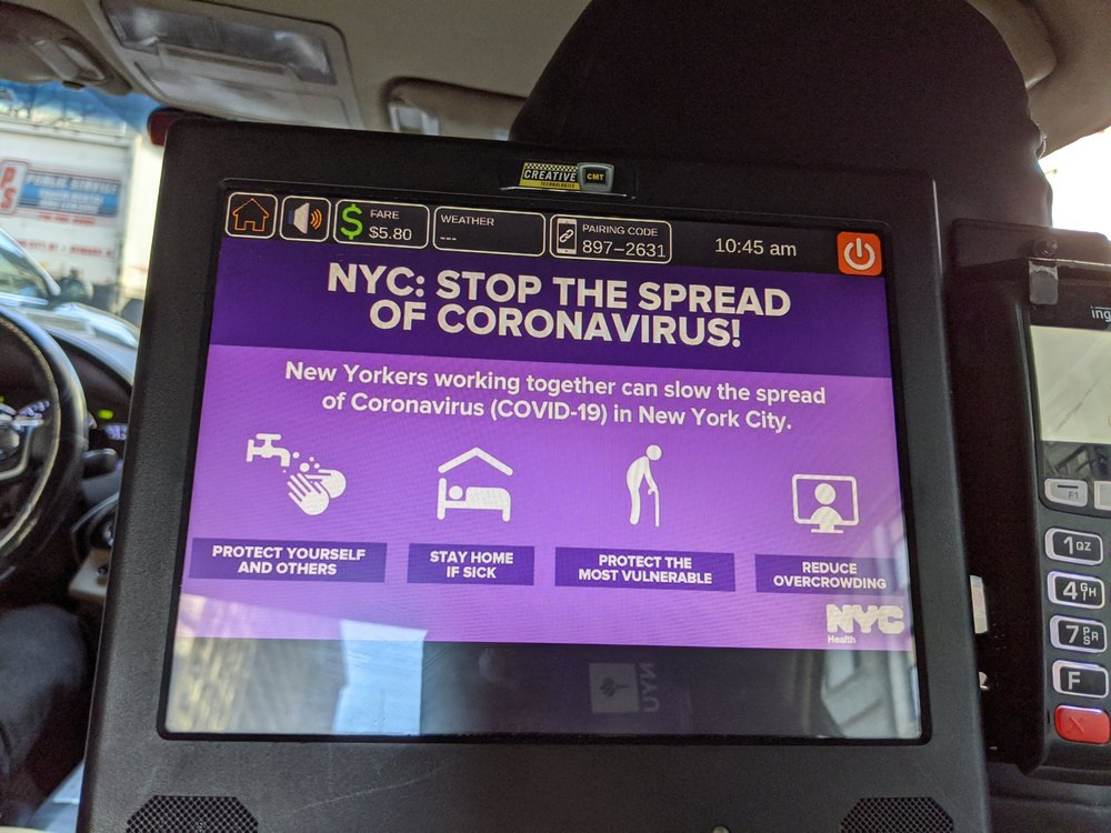 Stop the Spread sign in New York City taxi
